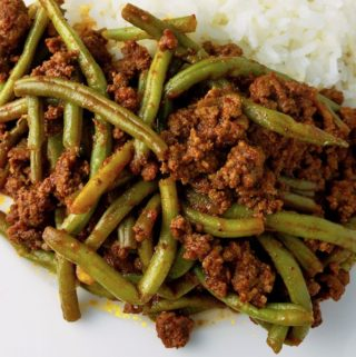 String Beans with Ground Beef and rice on a plate.