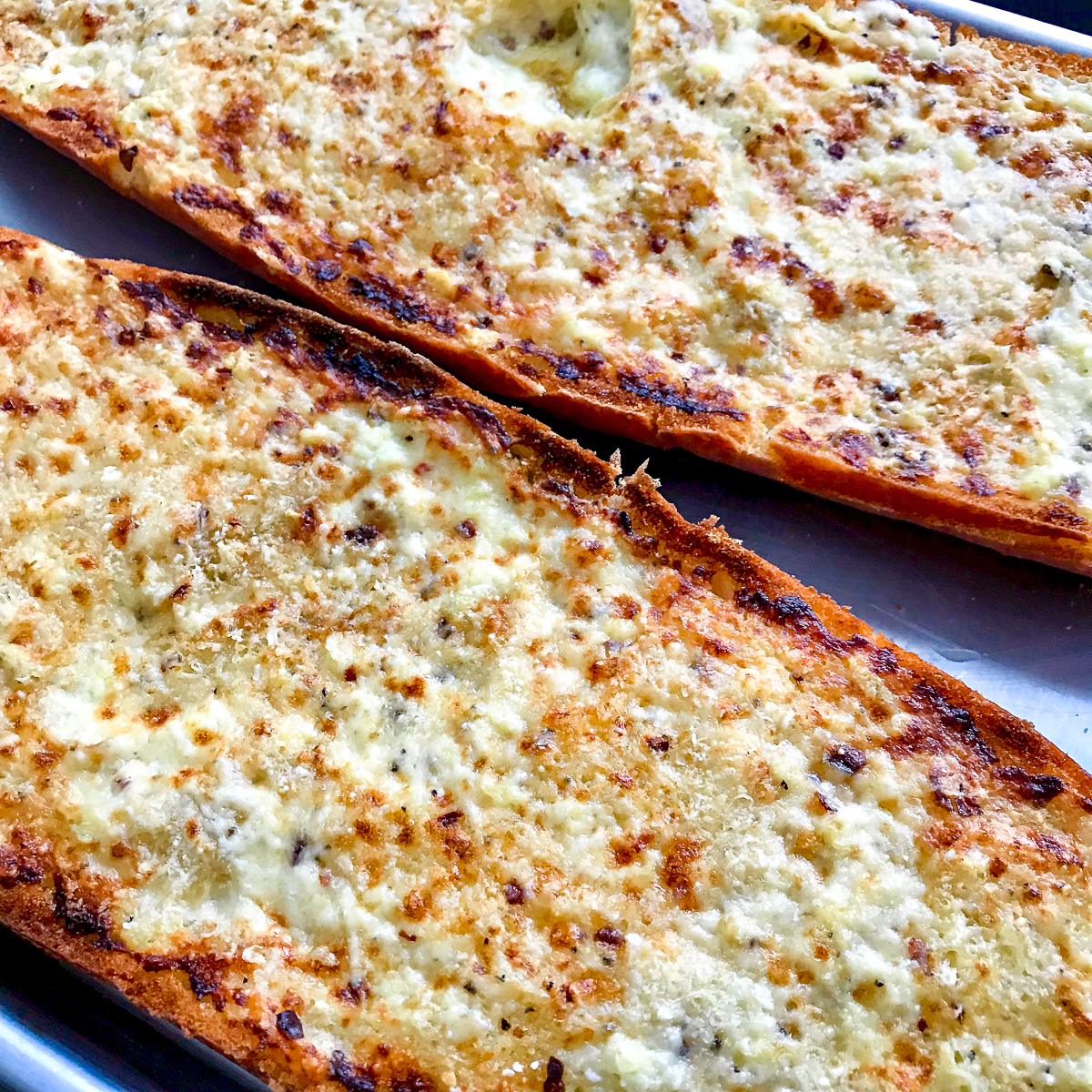 Diagonal closeup of creamy garlic bread.