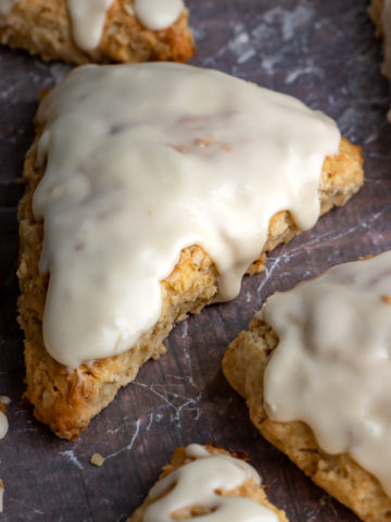 Iced maple scones on a board.