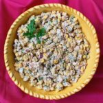 A bowl of Mexican street corn salad.