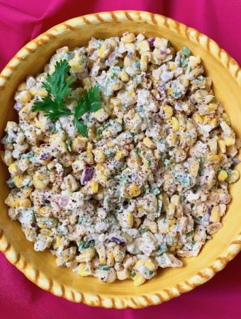A bowl of Mexican street corn salad.