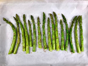 Roasted asparagus on a baking sheet.