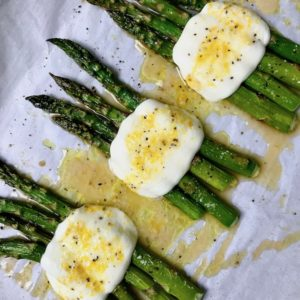 Roasted asparagus with melted mozzarella and lemon dressing.
