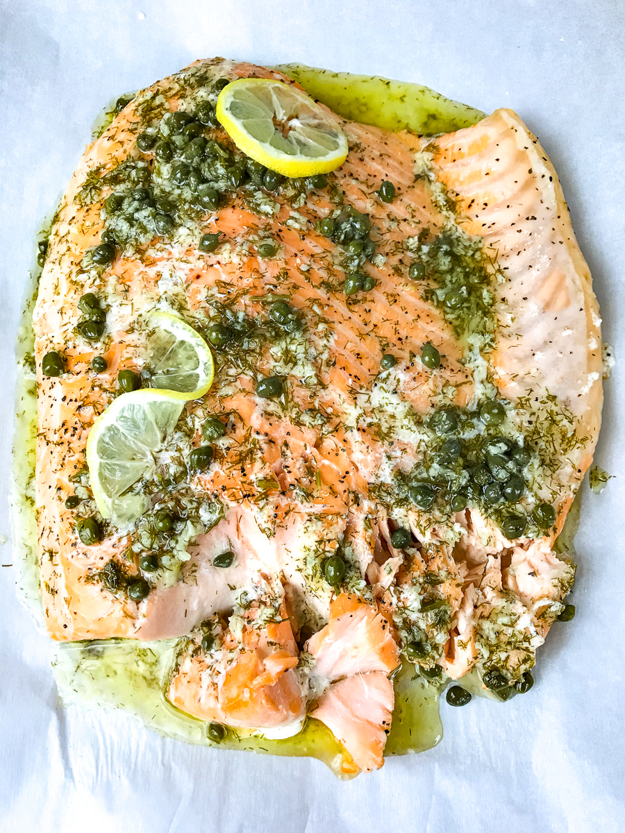 A slow roasted salmon fillet covered with lemon dressing.