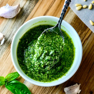 Fresh Italian pesto in a white bowl.