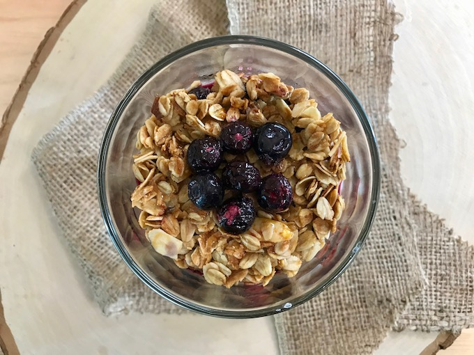 A top view of blueberry parfait topped with granola and blueberries.