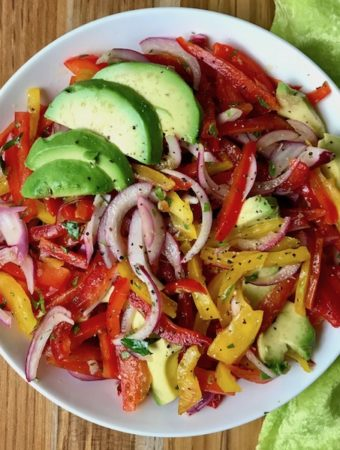 A bowl of sweet pepper and avocado salad.