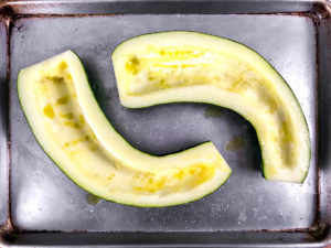 A large zucchini with the seeds removed to form a channel for stuffing.