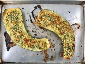 Parmesan roasted zucchini on a baking sheet.