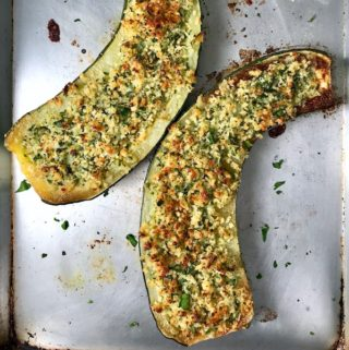 Parmesan roasted zucchini on a baking sheet.
