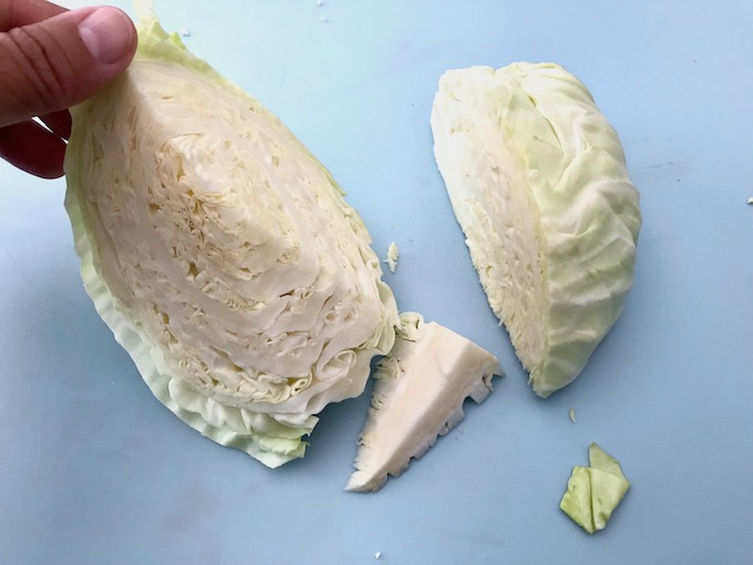 Removing the core from a cabbage.