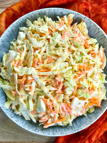 A bowl of creamy coleslaw.