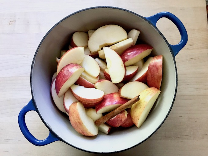Sliced apples in a saucepan.