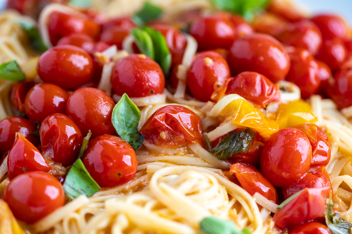 Cherry tomatoes, basil and pasta all tossed together.