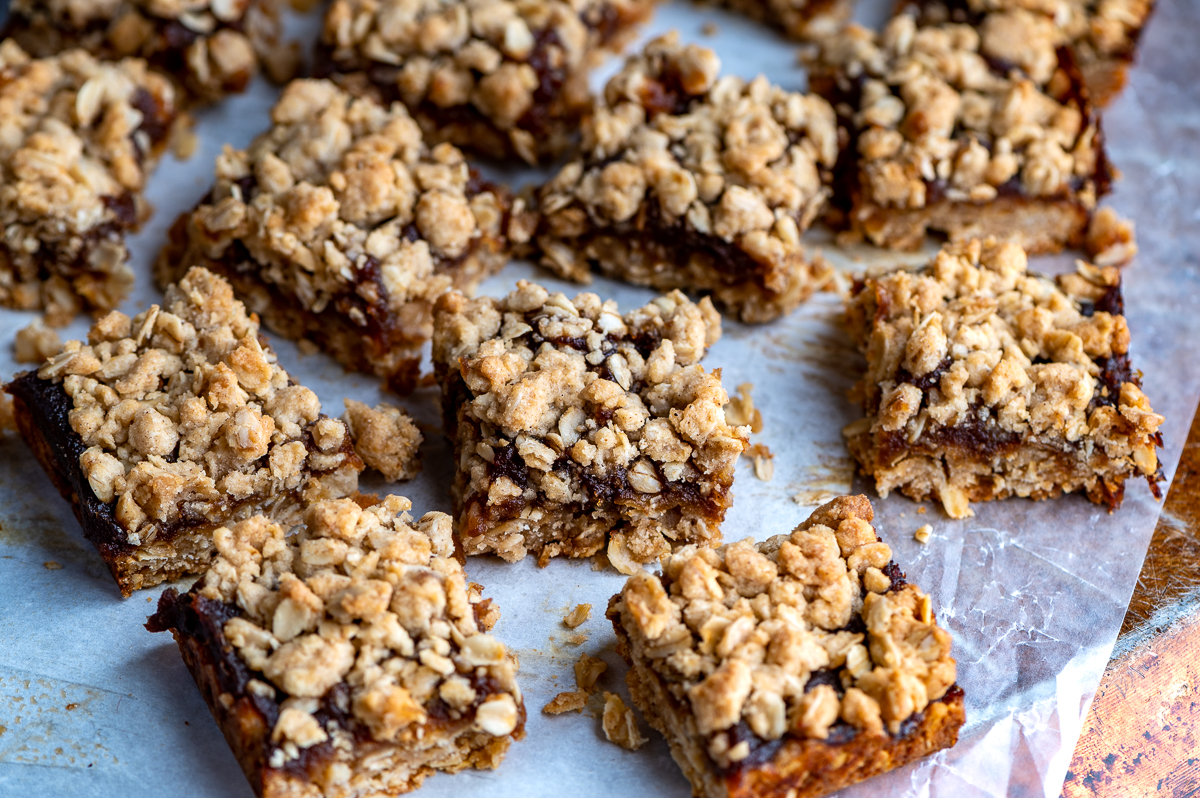 Cut apple butter oatmeal bars on parchment paper.