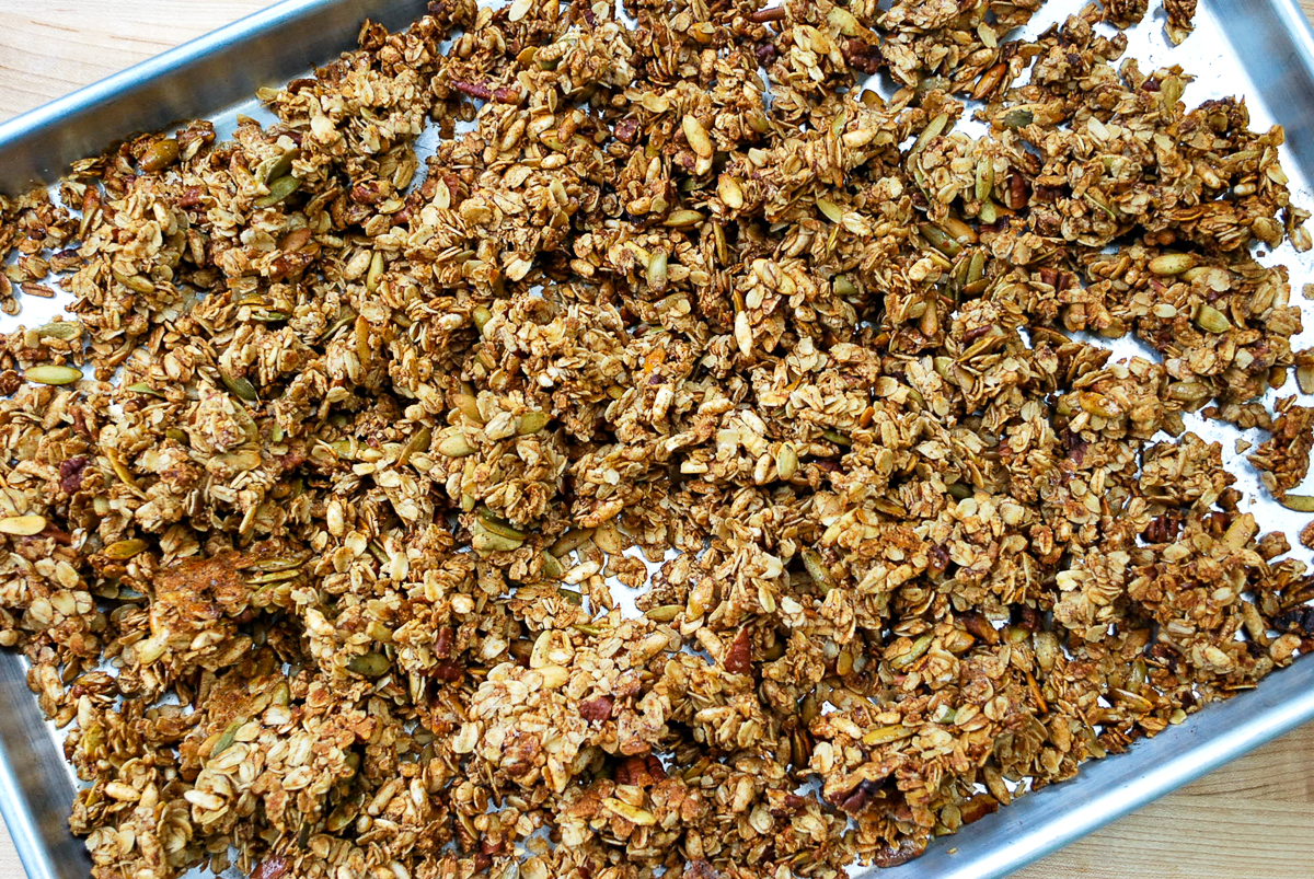 Bakeed pumpkin spice granola on a baking sheet.