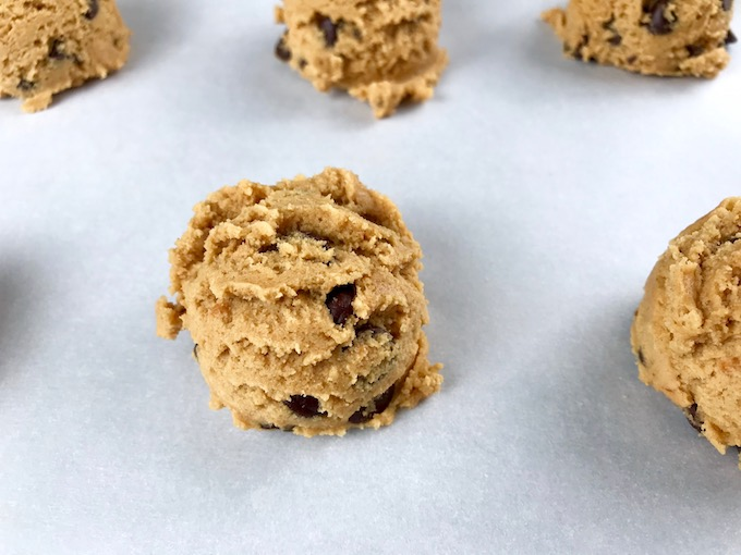 A scoop of cookie dough on a baking sheet.