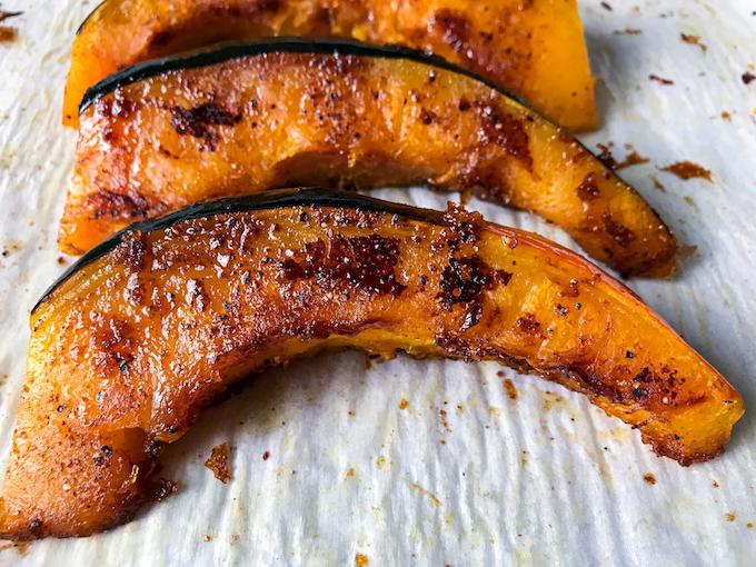 Roasted acorn squash on a baking sheet.