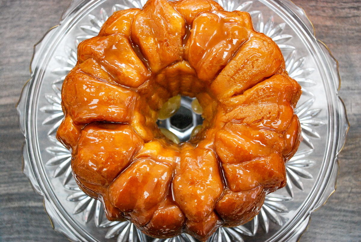 Monkey bread without icing on a cake plate.