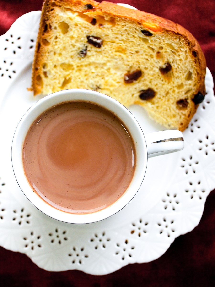 A cup of Peruvian hot chocolate with a slice of panettone.