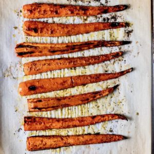 Roasted carrots on a baking sheet.