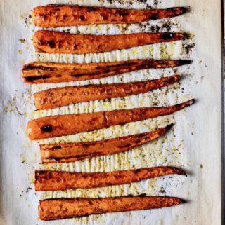 Roasted carrots on a baking sheet.