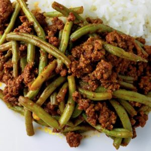 Closeup of ground beef with string beans.