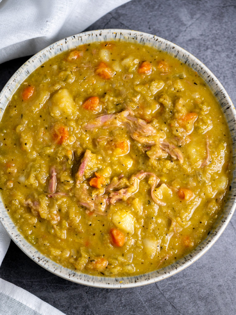 A bowl of split pea and ham soup.