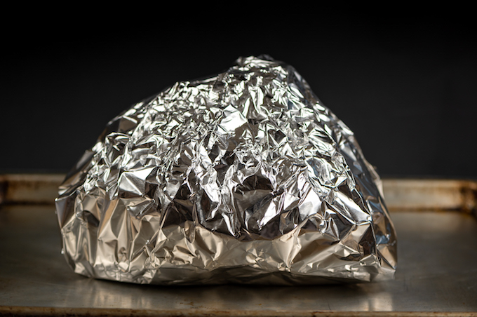 A ham wrapped in foil.