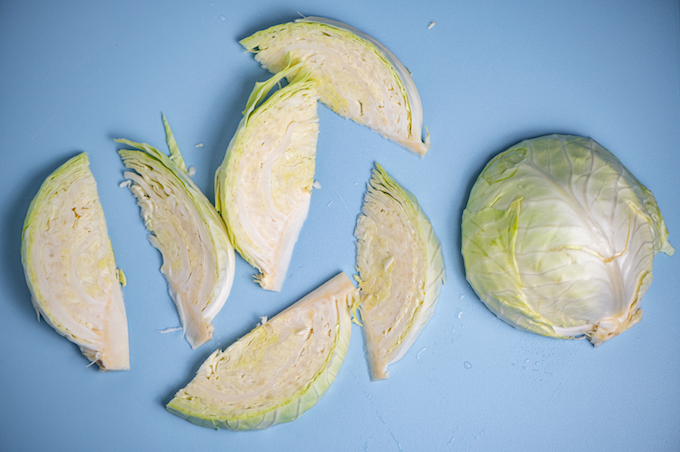 Slicing cabbage into wedges.