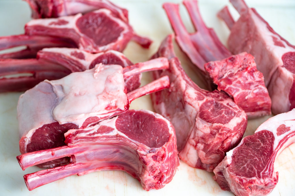 Two racks of lamb chops sliced in portions.