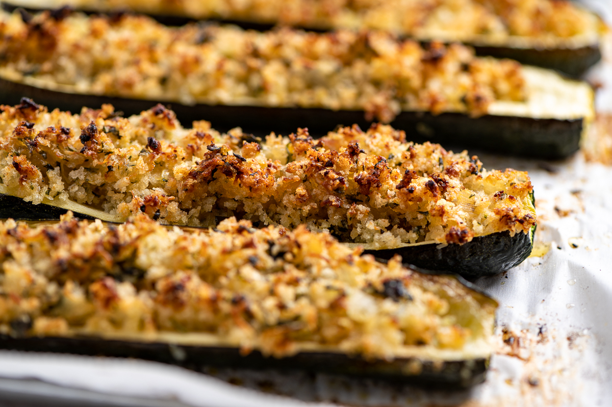 Golden brown Parmesan roasted zucchini on a baking sheet.