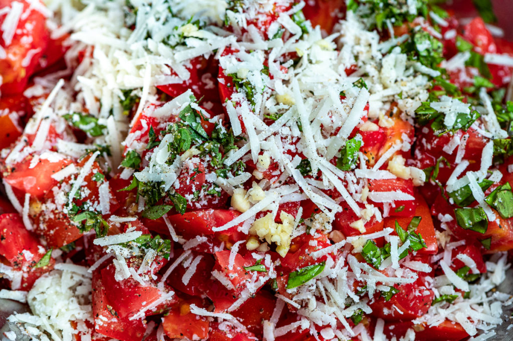 Chopped tomatoes, chopped basil, shredded cheese and spices.