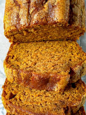 A sliced loaf of pumpkin bread.