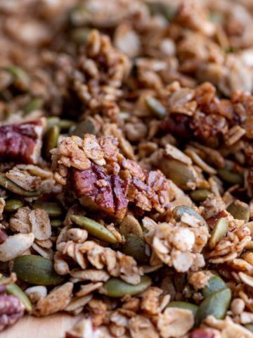 Closeup of oats, pecans, and pumpkin seeds.
