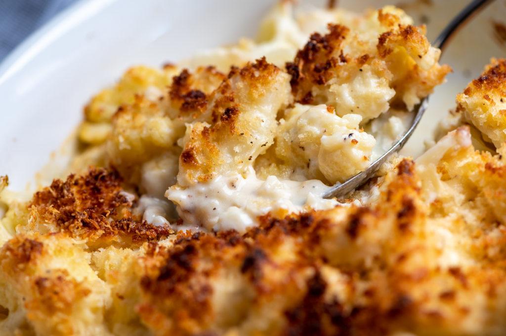A scoopful of creamy cauliflower gratin.