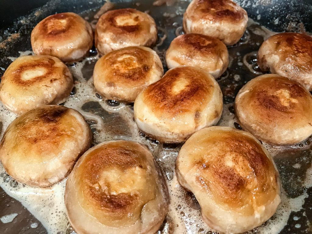Browned mushrooms in a skillet.