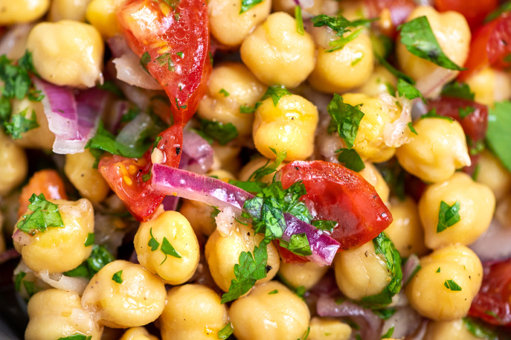 Chickpeas, tomatoes, red onions, and cilantro mixed together.