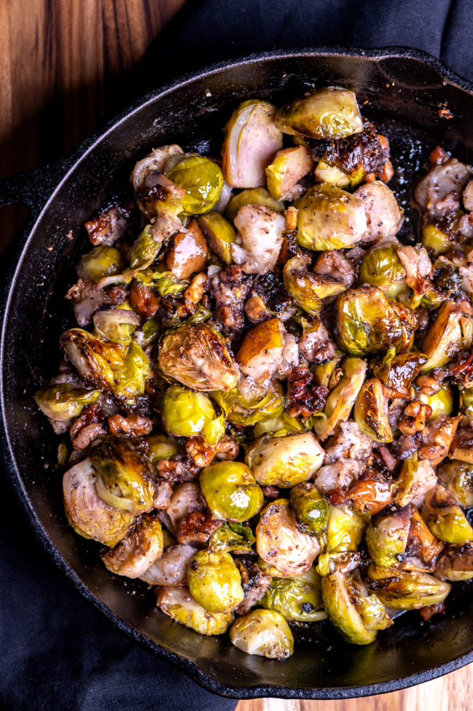 Roasted Brussels sprouts in a cast iron skillet.
