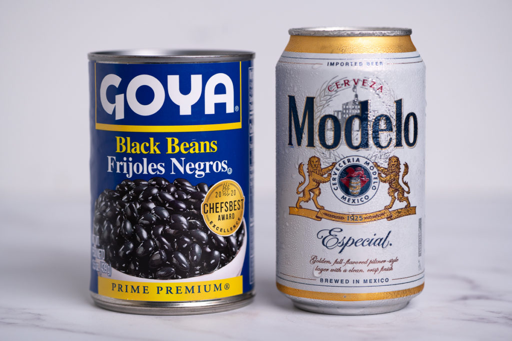 A can of Goya black beans and a can of Modelo beer.