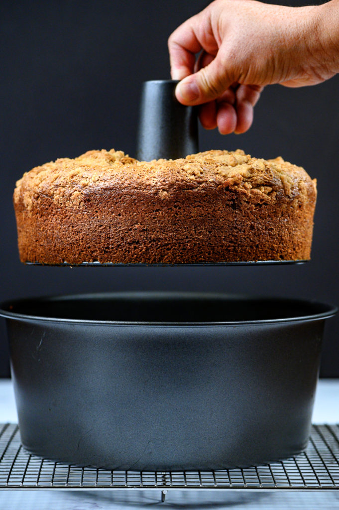 Lifting out a cake from a tube pan.